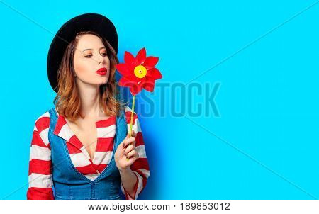 Woman With Red Pinwheel