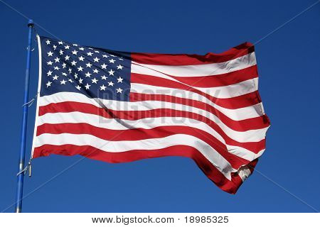 An American flag flaping boldly in the wind.