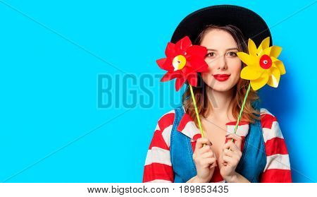 Smiling Woman With Two Pinwheels