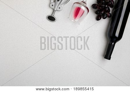 Bottle of red wine with glasses on white background. Mock-up. Top view with copy space. Flat lay