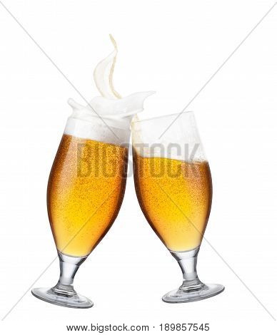 two glasses of beer toasting creating splash isolated on white background. Cheers. Pair of beer goblets making toast. Beer up. Golden beer splash