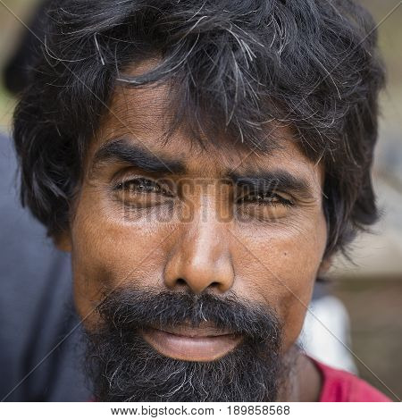 KATHMANDU NEPAL - SEPTEMBER 29 2016 : Portrait poor men in street Kathmandu Nepal