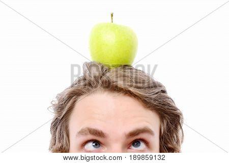 Caucasian Man Holds Green Apple On His Head