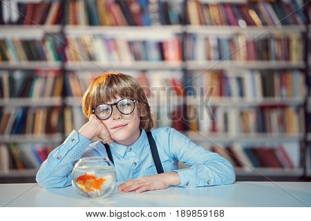 Dreaming boy in library