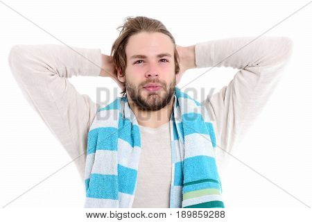 Happy man awake. Bearded guy with open smiling face and white blue towel wakes up and stretches. Isolated on white background. Perfect morning concept