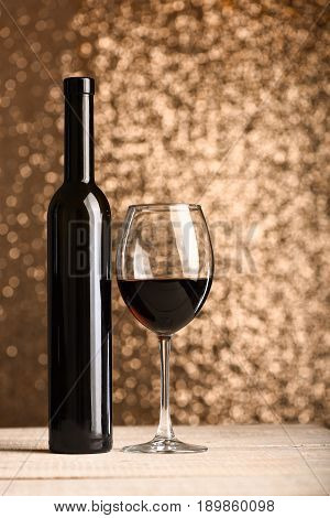 Concept Of Party And Alcohol Degustation: Bottle Near Filled Glass
