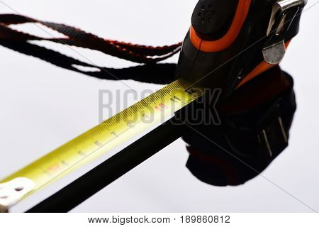 Measuring Tape With Self Retracting Mechanism On Grey Surface