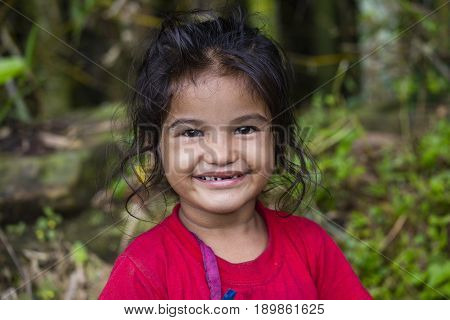 HIMALAYAS ANNAPURNA REGION NEPAL - OCTOBER 05 2016 : Portrait nepalese child on the street in Himalayan village Nepal
