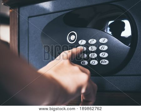 People hand on Safe lock Pad number secret Password Security Protection