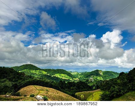 Mountain and cloud scenery.Beautiful mountain landscape, with mountain peaks covered with forest and a cloudy sky