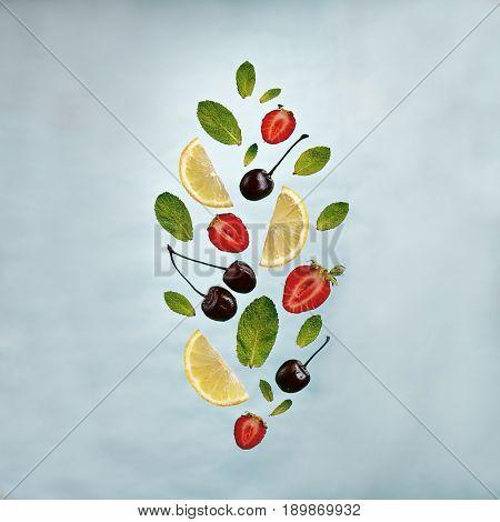 Summer Food and Drink - Fruit Lemonade Ingredient Pattern made of Strawberries, Cherries, Mint and Lemon. Splash Shape with Flying Drink Ingredient. Summer Fruit Drink Ingredient Concept. Flat Lay