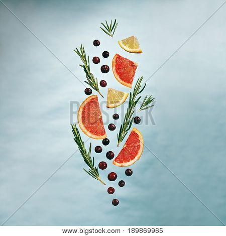 Summer Food and Drink - Fruit Lemonade Ingredient Pattern made of Grapefruit, Lemon, Rosemary and Cranberry. Splash Shape with Flying Drink Ingredient. Summer Fruit Drink Ingredient Concept. Flat Lay