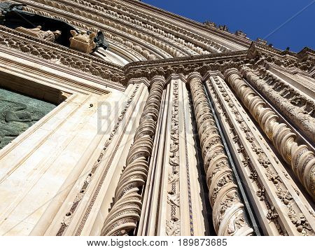 Fragment of the arch portico of a Catholic Cathedral. Italian architecture of the Middle Ages in the Umbria region, Italy