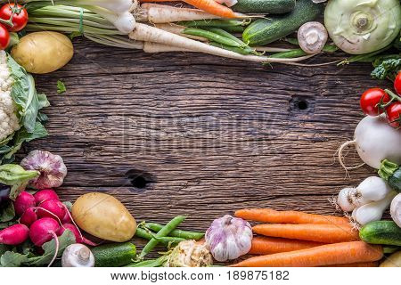 Vegetable. Assortment of fresh vegetable on rustic old oak table. Vegetable from market place.