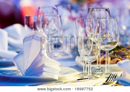 catering table set service with silverware, napkin and glass at restaurant before party