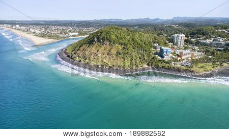 Aerial view of Burleigh Headland National Park, facing the coastline south to Tallebudgerra. Gold Coast, Australia