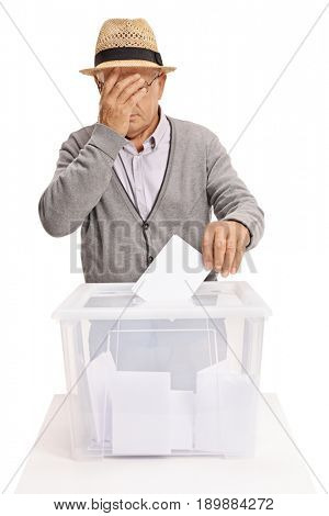 Senior voting and holding his head in disbelief isolated on white background