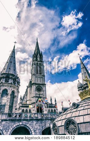 Basilica of our Lady of the Rosary blue sky. Lourdes, France, Hautes Pyrenees