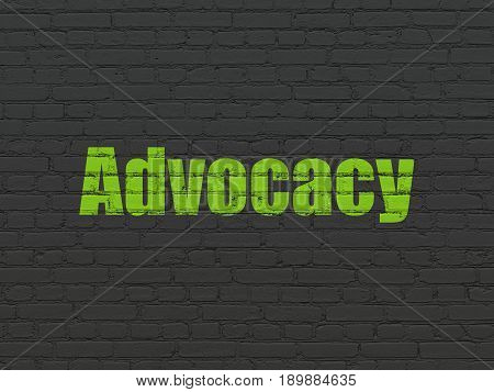 Law concept: Painted green text Advocacy on Black Brick wall background