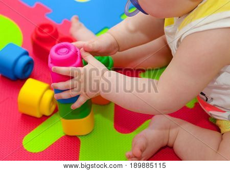 Toddler Plays With Building Block