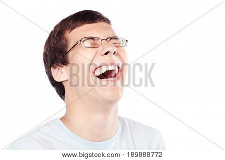 Close up of young hispanic man wearing glasses laughing out loud with closed eyes  over white background - laughter is best medicine concept