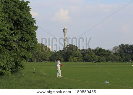 LONDON, GREAT BRITAIN - MAY 17, 2014: An unidentified rugby player stands on a sports field in the Regent's Park on the background of the BT Tower.