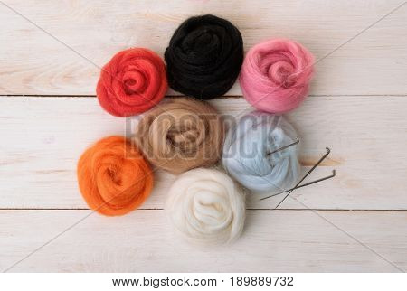 Top view of wool needle felting kit isolated on white