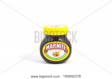 YATELEY, UK - FEBRUARY 9: Marmite yeast extract made by Unilever, a Dutch-British consumer goods company. First produced in 1902, Marmite is a byproduct of beer making. Yateley, UK - February 9, 2017