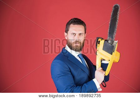 Businessman Or Serious Bearded Man Hold Yellow Chainsaw In Outfit