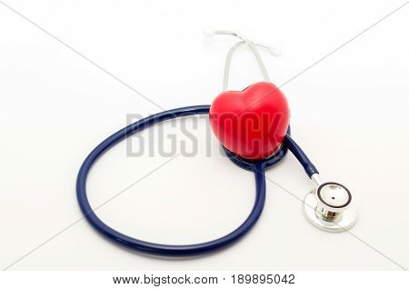 red heart and a stethoscope on white background, health care medical technology concept, soft focus, selective focus.
