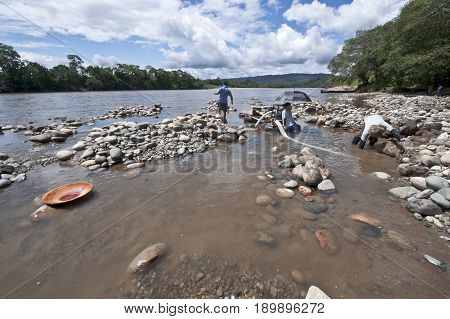 Local Indians People Panning For Gold In The Napo River,  Ecuadorian Amazon