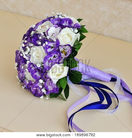 Wedding flowers bridal bouquet closeup. Decoration made of roses.