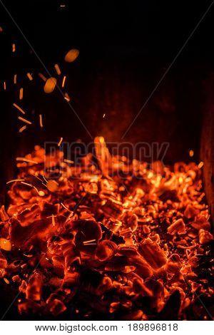 Burning coals at night , Decaying charcoal, barbeque season
