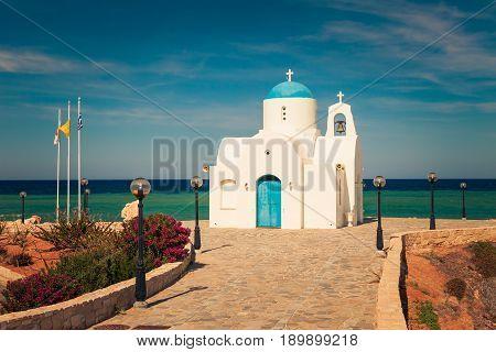 Orthodox Church Near Of Protaras And Cavo Greco, Cyprus Island, Mediterranean Sea. Bright Sunny Day.