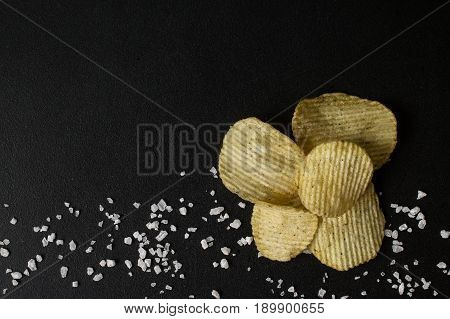 Crinkle Cut Potato Chips On A Chalkboard