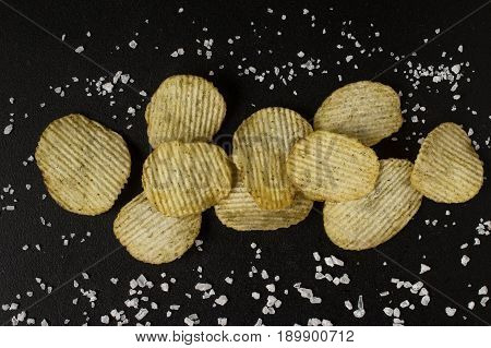 Crinkle Cut Potato Chips On A Chalkboard.