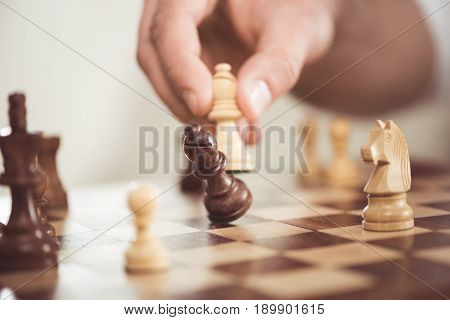 Close Up View Of Man Playing Wooden Chess Alone