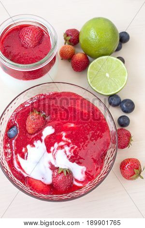 Strawberry fruit smoothies with fresh strawberries, lime and blueberries.