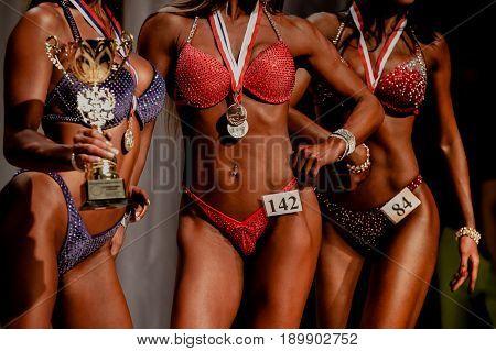 women athletes fitness bikini winners of bodybuilding competitions