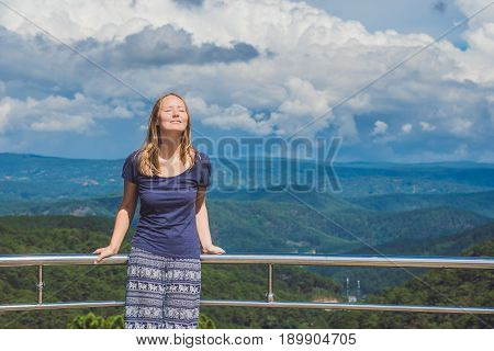 Hiker With Backpack Relaxing On Top Of The Mountain. Ecotourism Concept Image, With Happy Female Hik