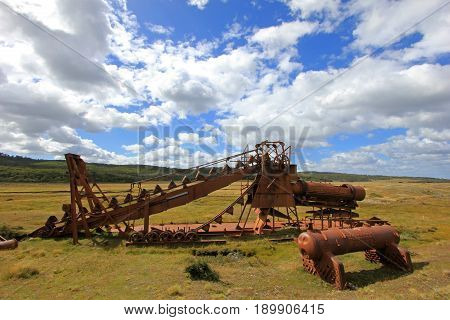 Abandoned gold dredge, near Lake Blanco, the english mechanical dredge was engaged in gold mining from 1904 to 1910, Tierra Del Fuego, Patagonia, Chile