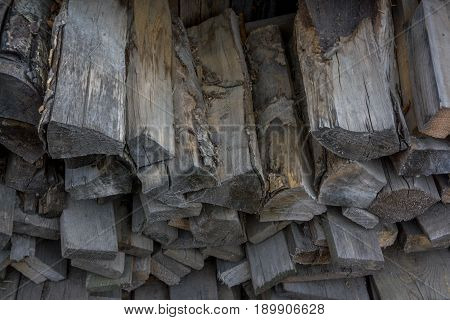 Pile Of Old Dark Firewood Close-up