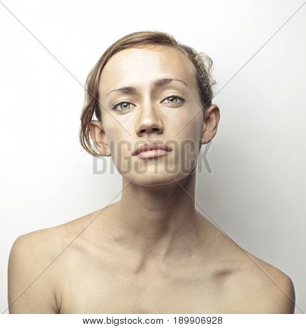 Androgynous woman with charming eyes