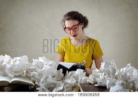 Writer surrounded by crushed paper