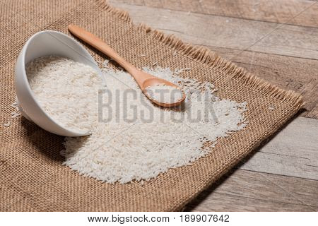 Rice in spoon and bowl. Jasmine Rice Thai Rice White Rice.