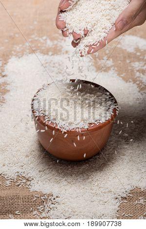 Rice In Spoon And Bowl. Jasmine Rice, Thai Rice, White Rice.