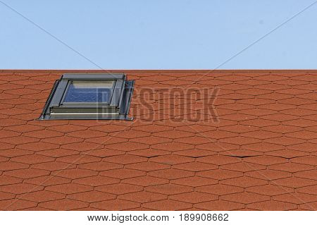 Part of the red roof with sunroof