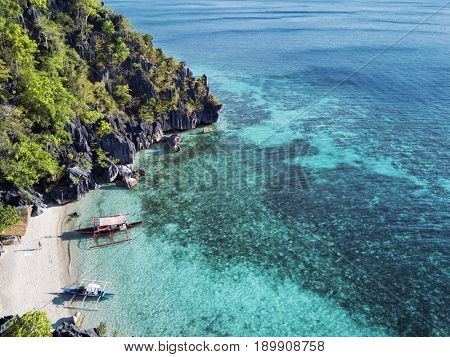 Aerial view of small tropical island beach with boats. Palawan May 2017
