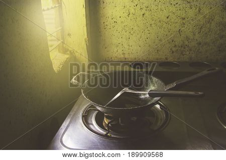 Frying pan with flipper in the kitchen in the morning