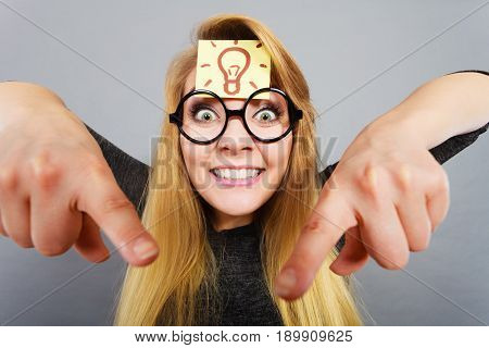 Intellectual expressions being focused concept. Woman wearing weird nerd eyeglasses having light bulb mark on forehead thinking about something having great idea or solution poster